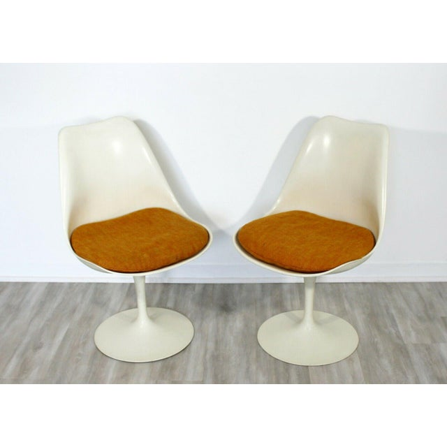 For your consideration is a fantastic, original set of five Tulip side dining chairs, with orange seats, by Eero Saarinen...