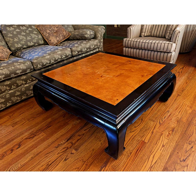 This ebony finished coffee table exudes Asian flair reminiscent of the Ming Dynasty period, with a natural wood grain top,...