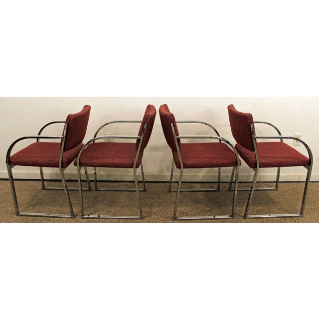 Offered is a very cool set of 4 mid-century modern dining chairs in the style of Milo Baughman. Includes four chrome flat-...