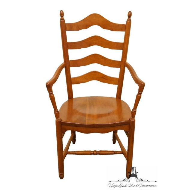 This is a vintage Tom Seely ladder back dining chair. The piece is made of solid cherry and features the Honey Cherry...