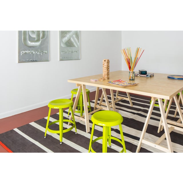 Set of four bright green kid's stools. Adjustable feet for stabilization. So fun and useful for art projects. Pair them up...