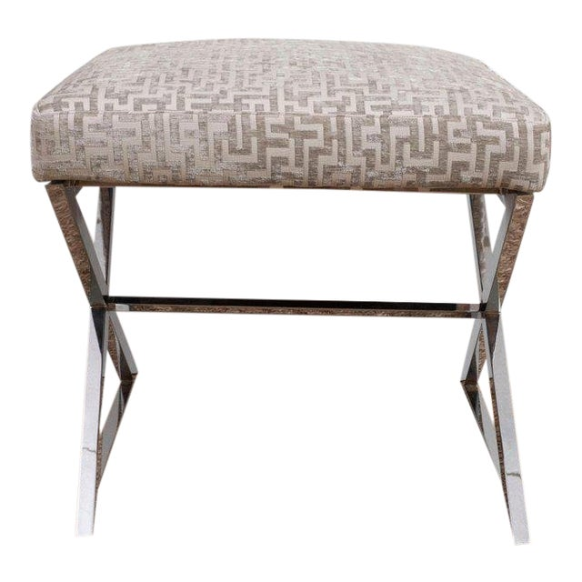 A pair of chrome X benches with grey and white geometric upholstery. Perfect for pull-up seating or tucked under a...