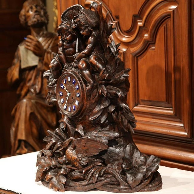 Decorate your desktop or library with this exquisite, antique walnut clock. Not only is the clock completely hand-carved,...