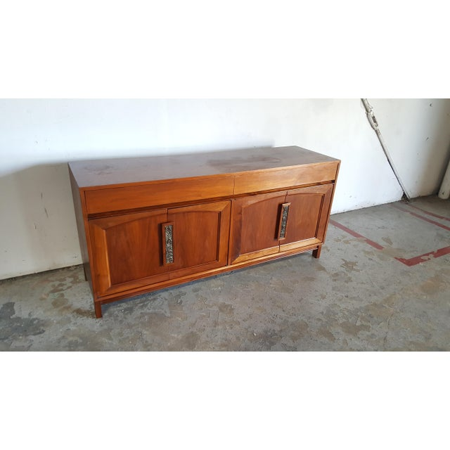 Stunning vintage mid century modern walnut credenza by John Keal for Brown Saltman. In over all good vintage condition....