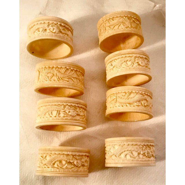 Beautiful Carved ivory colored dragon motif napkin rings. They appear to be hand carved since each is slightly different....
