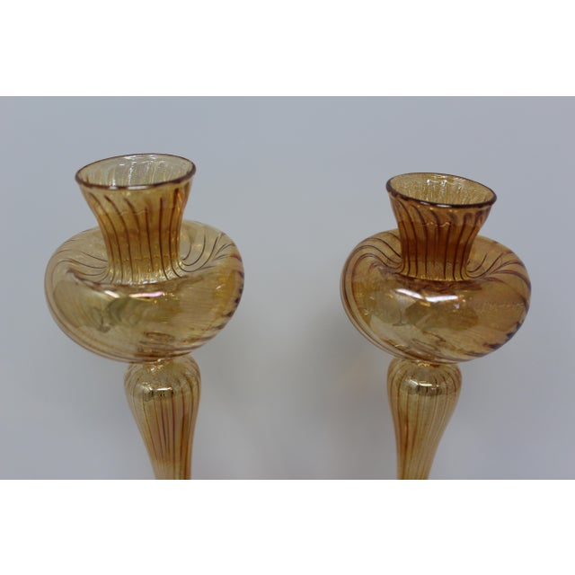 This lovely pair of candle holders were hand-formed by Murano Glass Master Ballarin. These are very light and beautiful....