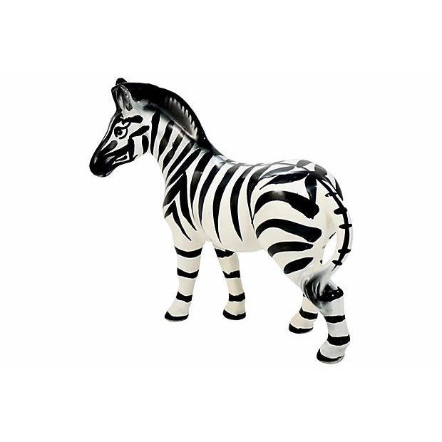 Large nine inch hand made Italian Capodimonte vintage ceramic zebra in repose intricately hand painted in black, ivory and...