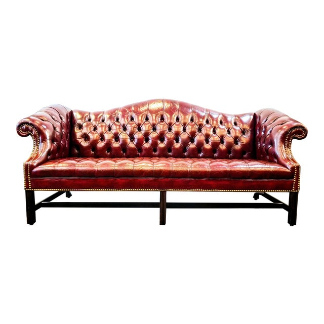 Vintage Burgundy Leather Button Tufted Camel Back Sofa With Antiqued Brass Nailheads For Sale