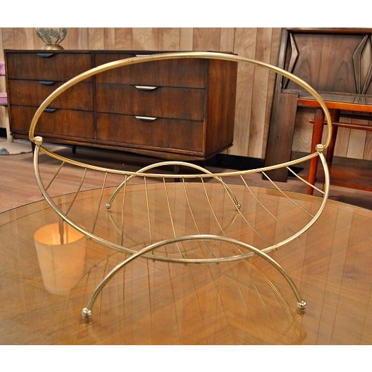 Great Atomic Era rack or basket. Tapered ends with brass design. The handle can be up or down. In good condition with age...