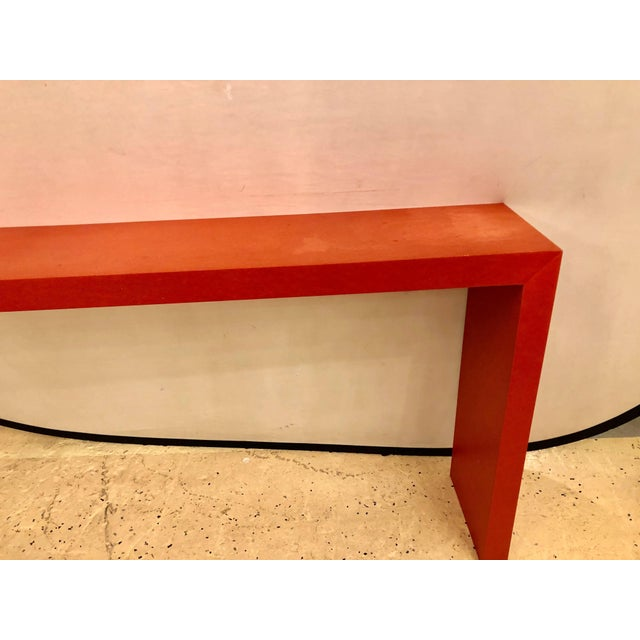 A faux paint decorated pier console or wooden bench in dark orange paint. This alter style table or bench is finely paint...