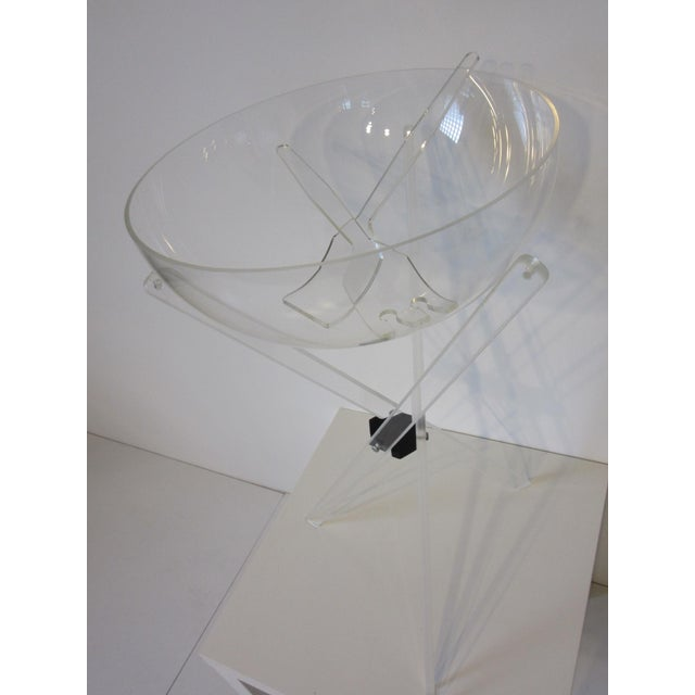 """A Lucite salad serving set with folding stand, large bowl and salad tools. The bowl is 15"""" in Dia. and the tool..."""