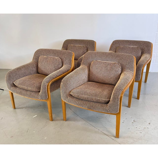 A gorgeous set of four modern and stylish model 1315 bentwood club lounge chairs designed by Bill Stephens for Knoll...