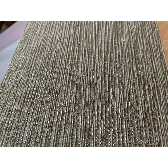 Silver & Gold silk metallic threaded woven face wall covering. This design is sure to add a subtle pop to any desired...