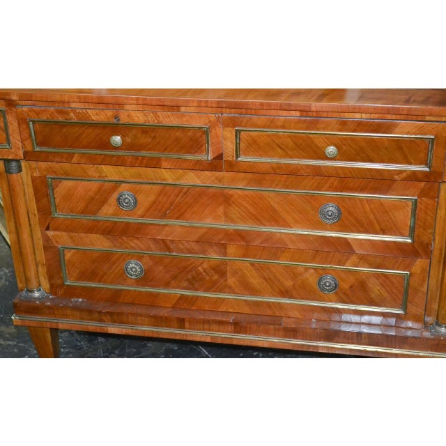 Excellent Continental walnut four-drawer commode with brass hardware and trim. Having a beautiful rich warm patina,...
