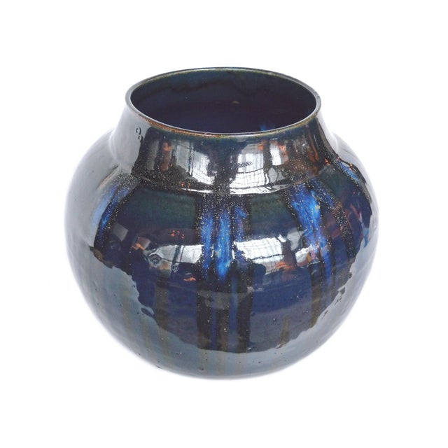 This one-of-a-kind midnight blue ceramic vessel is created by Thom Lussier. Like in many of his pieces, the glazing he...