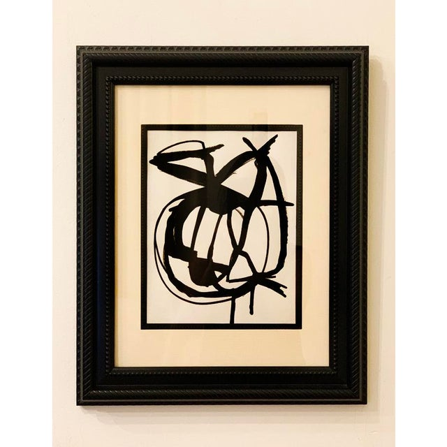 This beautiful abstract acrylic painting on paper is matted and framed in a black carved frame. 14.5 in. wide x 19 in....