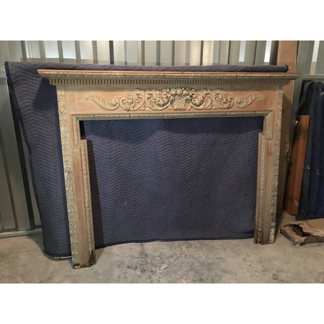 Antique English carved pine mantel circa 1920. Carved and applied garlands with center Fruit Basket decoration. Originally...