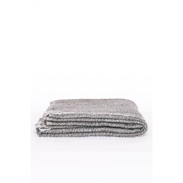 Onyx + white small diamond patterned throw blanket. Hand-woven in deliciously soft cashmere in kashmir, india.
