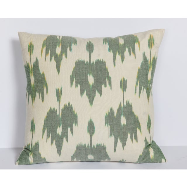 A single ikat pillow in pale green and cream. Add this lovely pillow to a bench or sofa for just the right amount of...