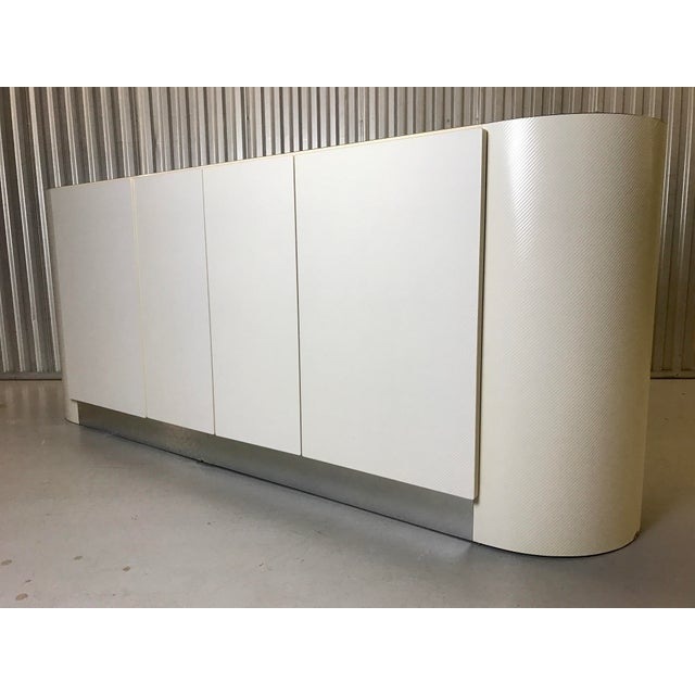 Fantastic and beautiful white credenza in manner of Karl Springer. Massive and out right beautiful piece of art this is...