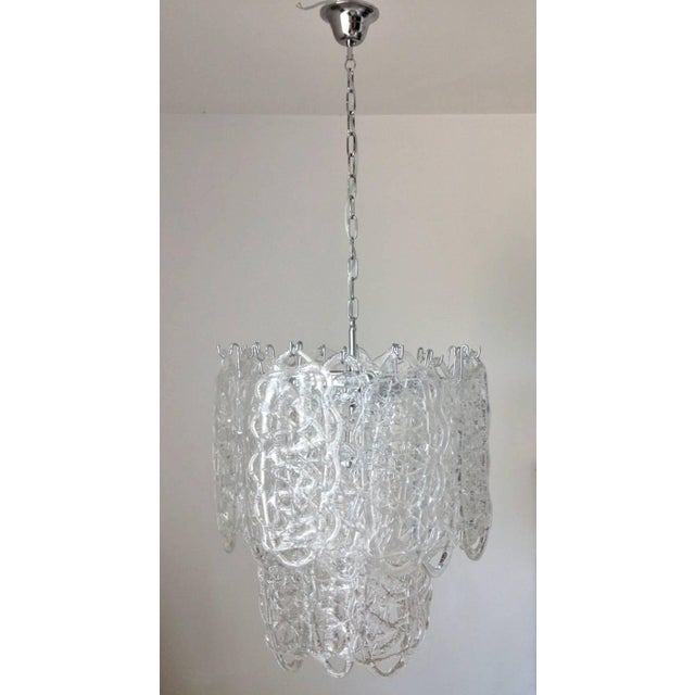 Italian vintage chandelier with 24 clear Murano glasses hand blown to form a beautiful cobweb design, mounted on nickel...