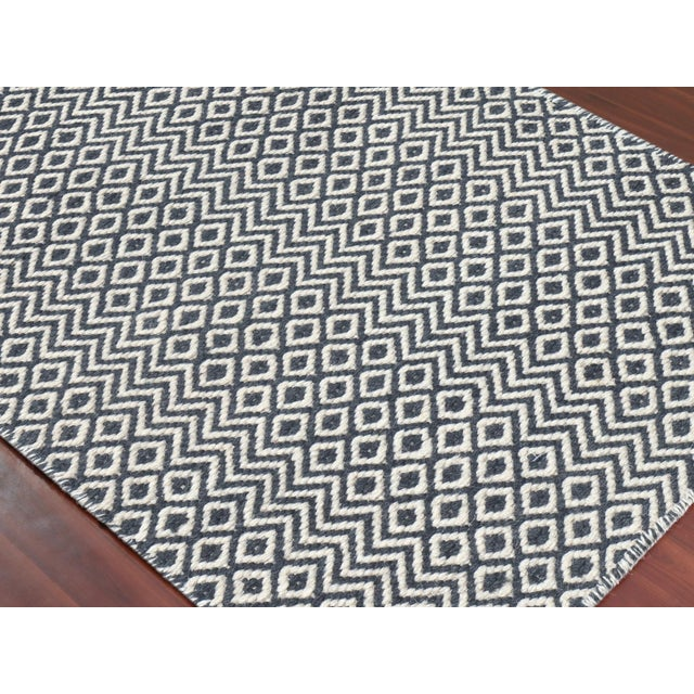 Bella is a remarkable collection of flat-woven wool rugs produced by our skilled craftsmen in India. Its reversible design...