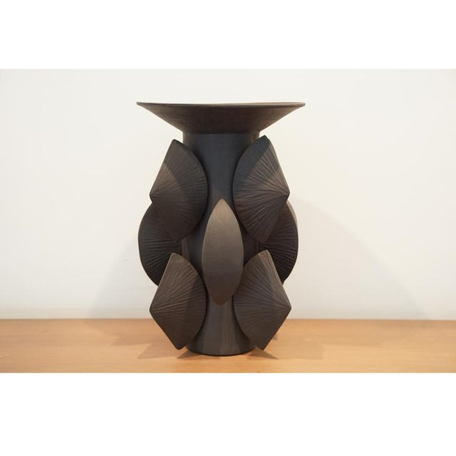 Artist: Titia Estes Clay: Black Glaze: Interior clear, no glaze on exterior. Titia Estes is native of California,...