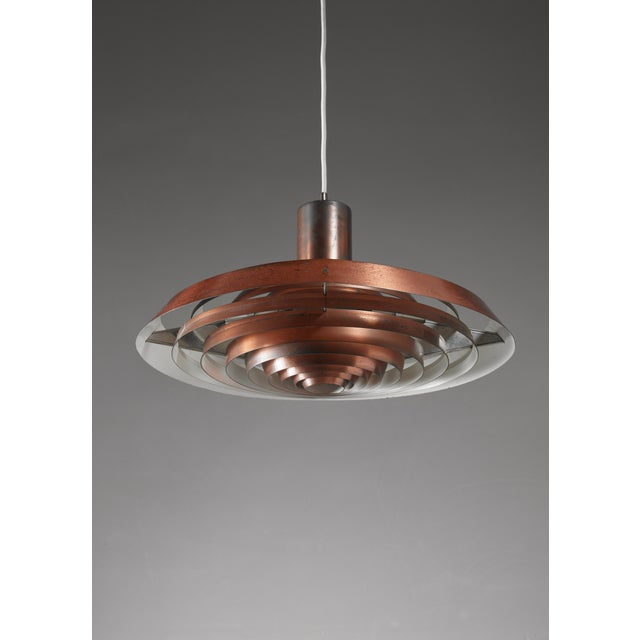 A model 'Tallerken' ('Plate') pendant for Louis Poulsen, Denmark. The lamp is made of concentric circles of copper. It was...