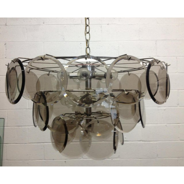 "Italian, Gino Vistosi 36 Disc chandelier for Murano. Glass discs are beveled. Measures: 25"" W (at it's widest) x 14.5"" H."
