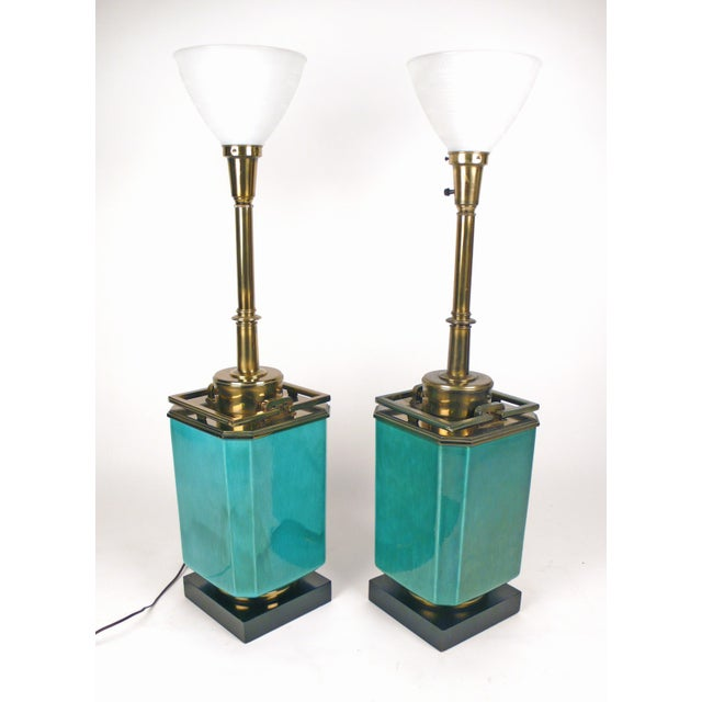 Monumental Jade colored ceramic table lamps with brass ornamentation and glass diffusers by Stiffel. Shades and finials...