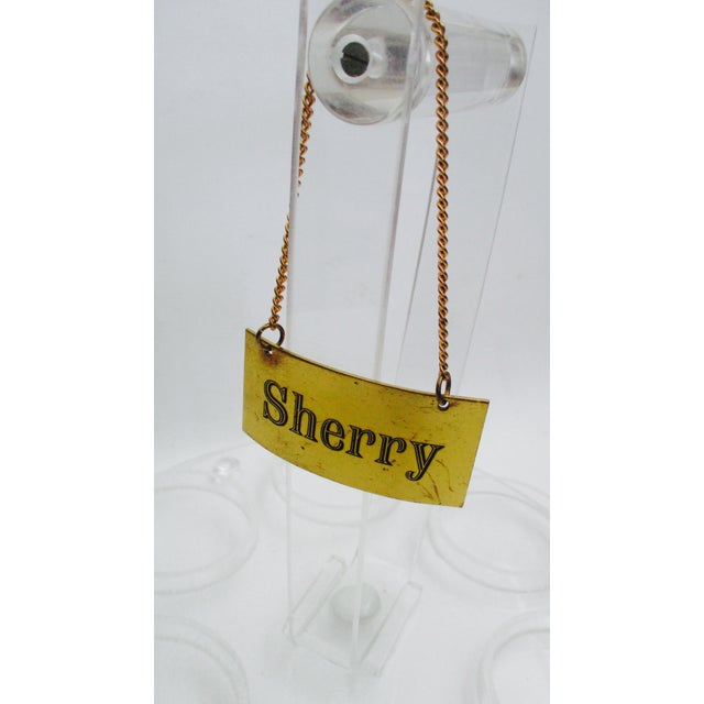 Made in Italy Dress up your decanters with this classic set of four detailed Brassr liquor labels with hanging chains....