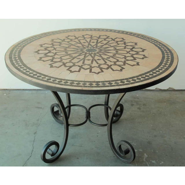 Moroccan round mosaic tile table delicately handcrafted by expert artisans in Fez, Morocco, using reclaimed old glazed and...