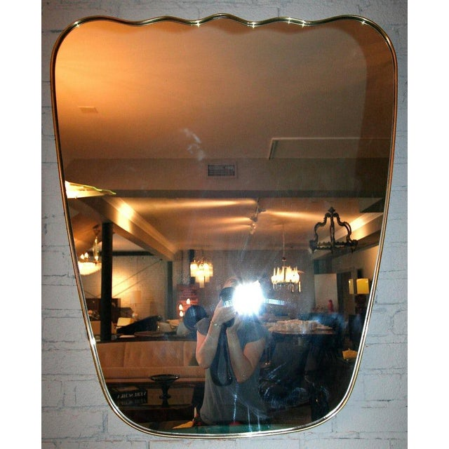 Italian wavy brass wall mirror. M-72