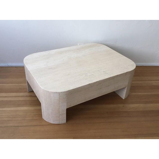 """A 1970s polished Italian travertine cocktail table. Newly professionally polished. Overall dimensions: 48"""" wide 36"""" deep..."""