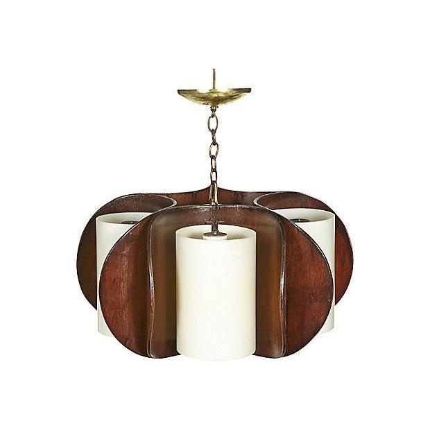 Mid-20th century modern five-light curved walnut wood and white plastic shade chandelier. Hard wired for the US and uses...