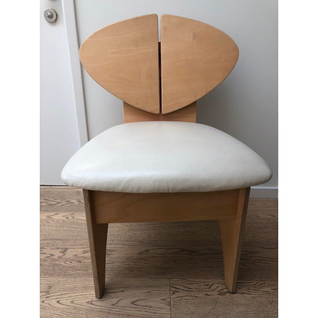 Mid-Century inspired custom dining chair- produced 2000, covered in ivory faux ostrich, blond wood, bonded plywood...
