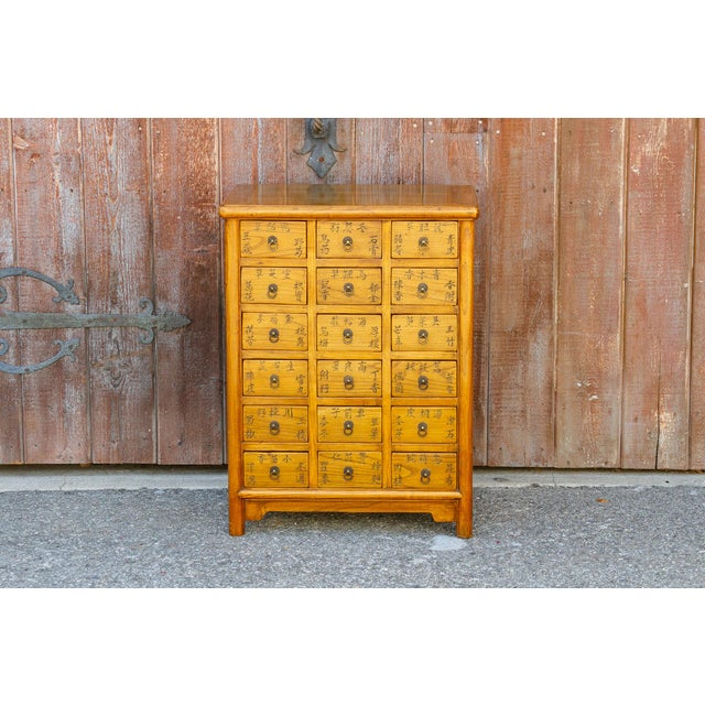 This petite golden elm chest was originally use to store herbal medicines. It its brilliantly constructed with mortise and...