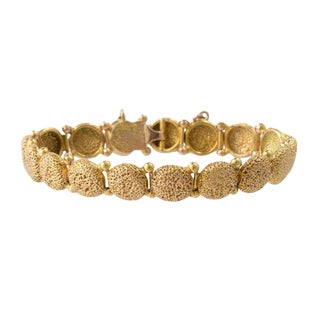 Victorian 14k Gold Articulated Repousse Bracelet For Sale