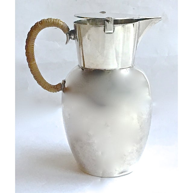 Vintage; 1910-1960, Mid-Century Modern, WMF, German, silverplated pitcher with flip-top lid and spout. Handle has reed...