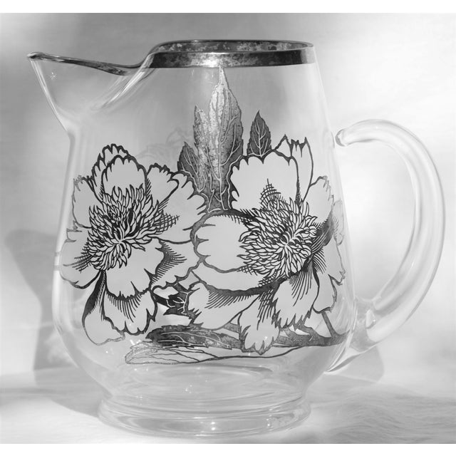 Exquisite glass pitcher by Silver City in the SCI1 pattern. The gorgeous flowers are frosted glass with sterling overlay...