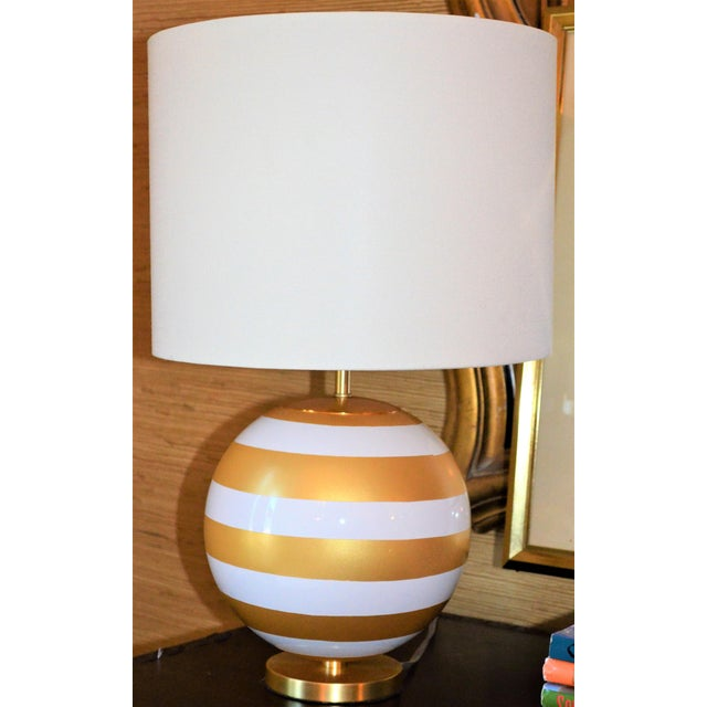 This is a gorgeous gold and cream stripped table lamp. This is a slightly smaller version of the Elsie lamp. It is new...