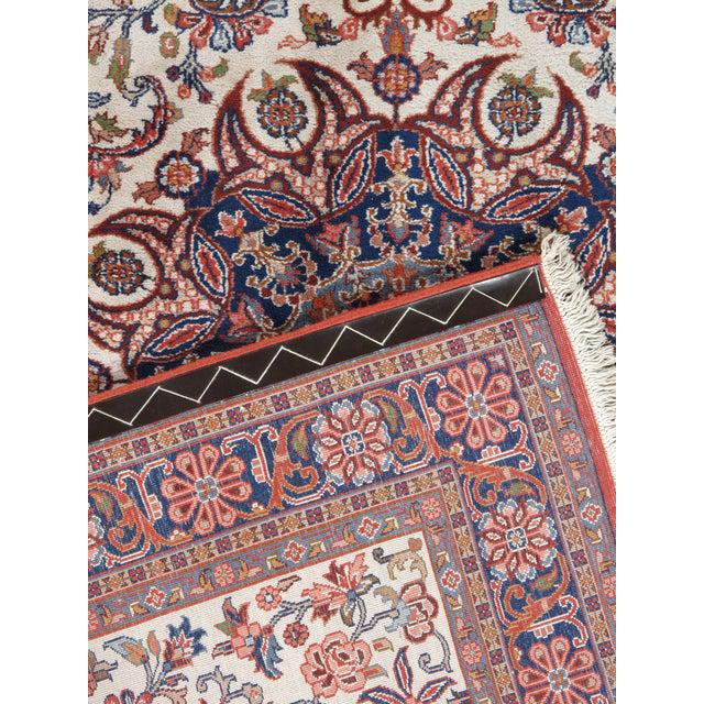 Vintage handwoven Persian sarouk rug featuring a central medallion and floral motifs. Color: brown/ivory/red/blue