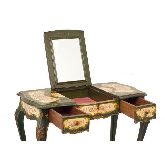 An elegant Italian Venetian Dressing Table/Desk made late in the 19th century in the mid 18th century style. This piece...
