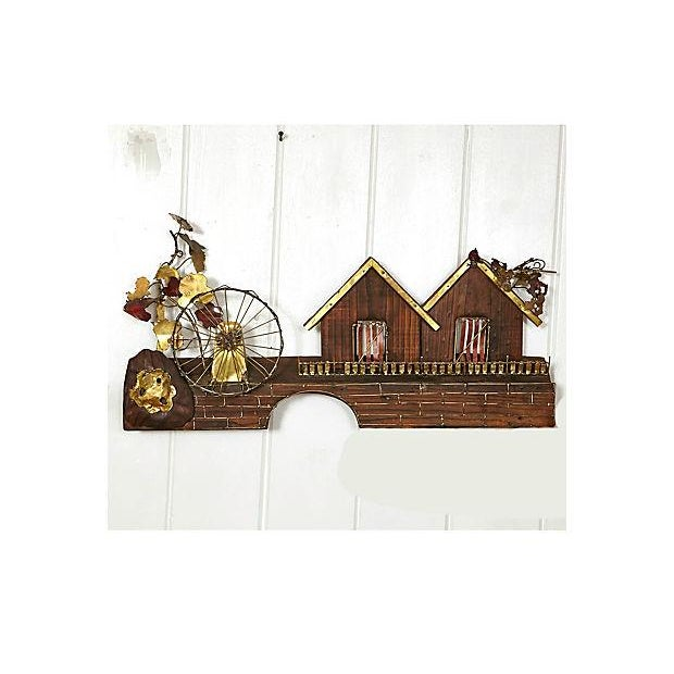 1970s metal wall sculpture with a waterwheel and house design. The perfect addition to a retro country-themed home.
