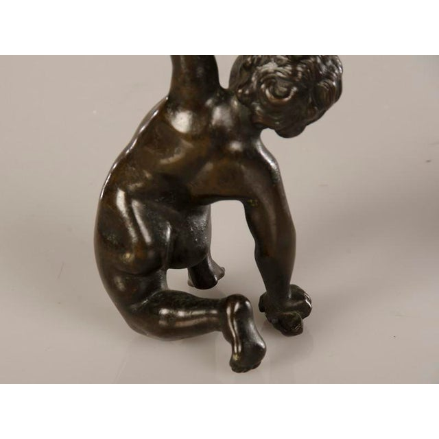 A pair of cast bronze candlesticks each featuring a kneeling putto from Italy c.1880 - Image 7 of 7