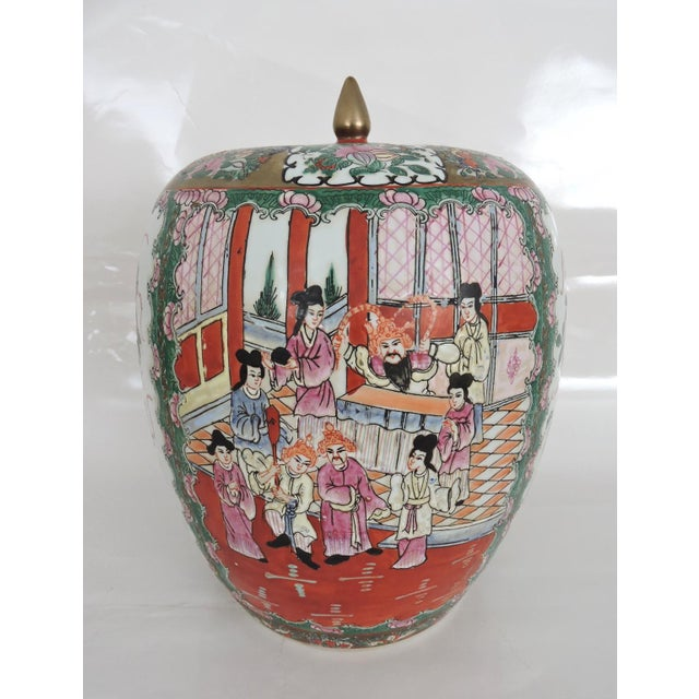 Antique ginger jar decorated in the Famille Rose Mandarin pattern. This high shouldered piece depicts foliage and birds on...