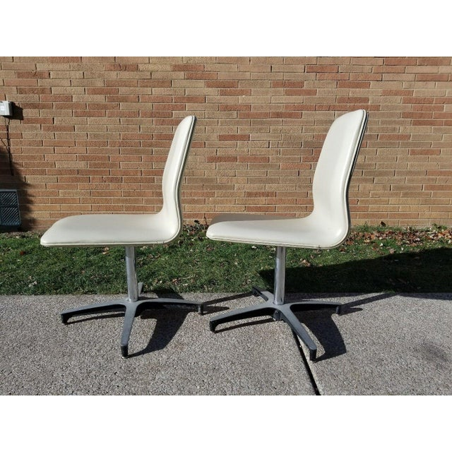 Pair of Chromcraft Vinyl Swivel Chairs. Good vintage condition. Aluminum and chrome bases in great condition with light...