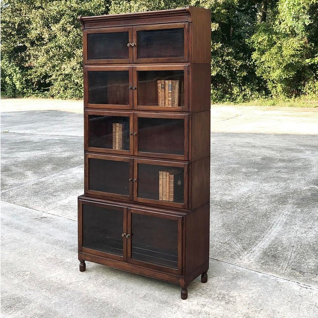 Antique English Mahogany Bookcase ~ File Cabinet is a study in tailored elegance, with the sheer natural beauty of the...
