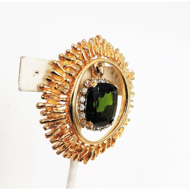 """1960s goldtone unfoiled faux-emerald and clear rhinestone pendant brooch with security clasp closure. Marked """"Panetta."""""""