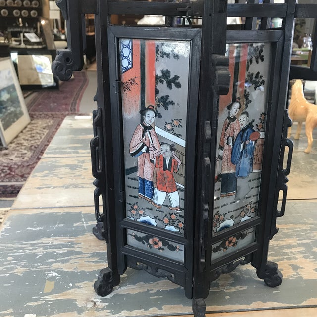 Antique Asian painted black wooden lantern in hexagon form with 6 painted panels and glass coverings.